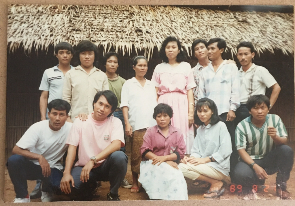 Mom, fourth from the left in the back row, in a refugee camp in Thailand